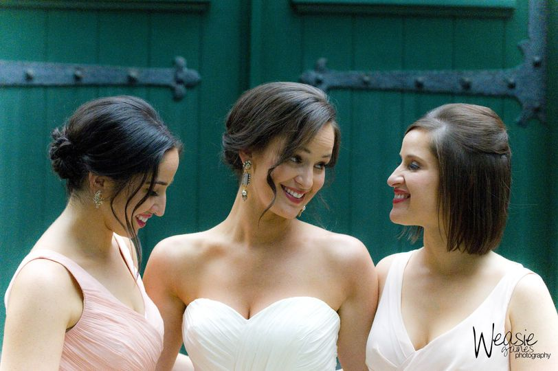 Updos of the bride and bridesmaids