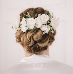 Braided updo complemented with white flowers