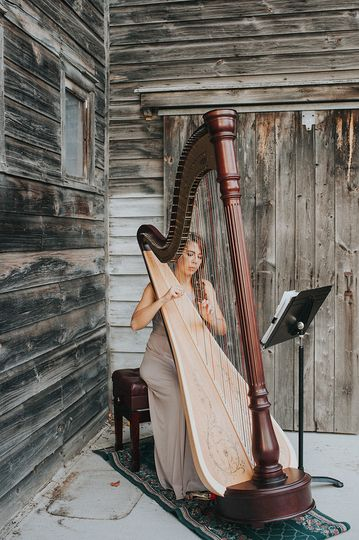 Lady playing the harp
