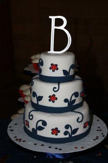3 tier fondant cake with gumpaste embellishments.