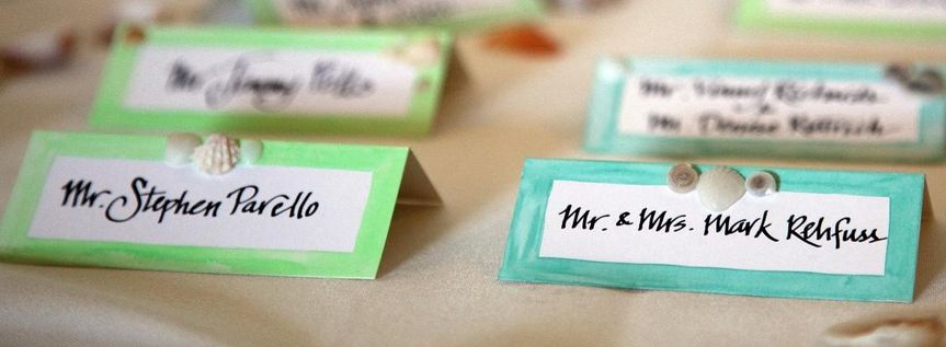 These custom place cards from Missy's Painted Reef had tiny sea shells and showcased the bride's two...
