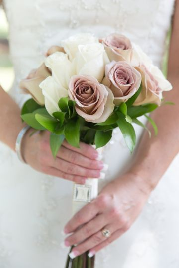 Ivory and Amnesia roses beautifully designed with ivory wrapped stems.