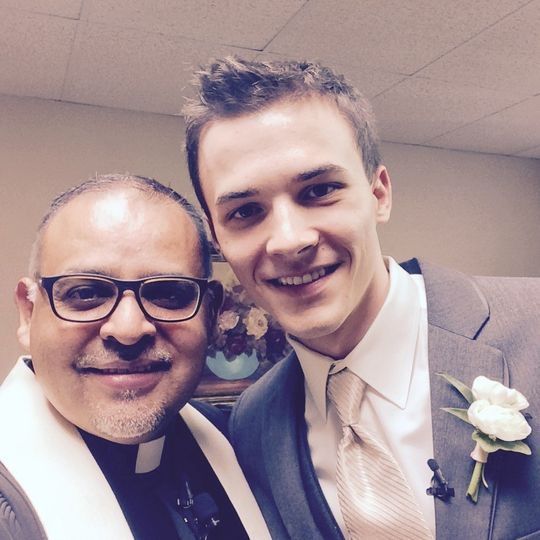 The groom and wedding officiant