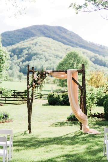 Sash and floral arch decor