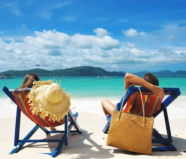 couple on beach in chairs