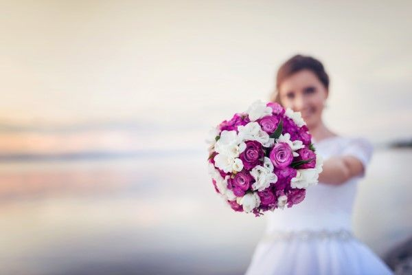 The throwing of the bridal bouquet from the upper deck