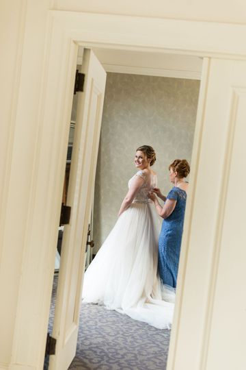 Sarah's mom helps her with the finishing touches at Greystone Hall.