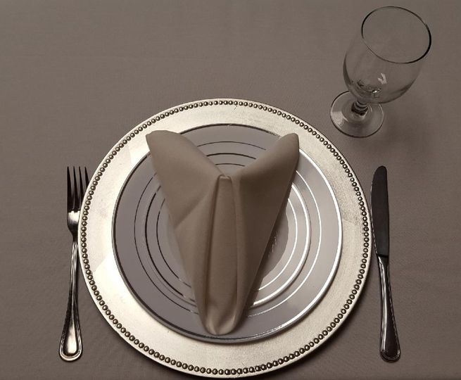 Simple setting with triangle tuck napkin