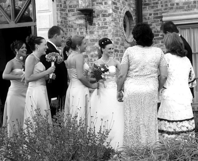 Wedding couple mingling with friends family and guests in black and white.