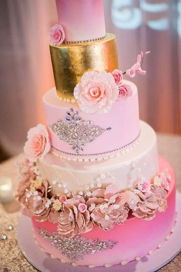 Pink floral wedding cake with gold layer