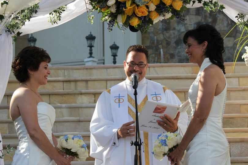 Officiating the wedding of the brides