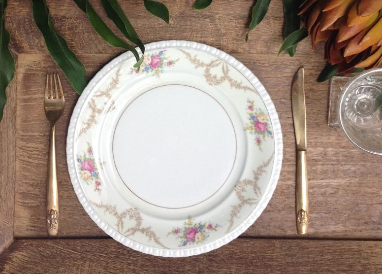 Mismatched vintage china with gold flatware