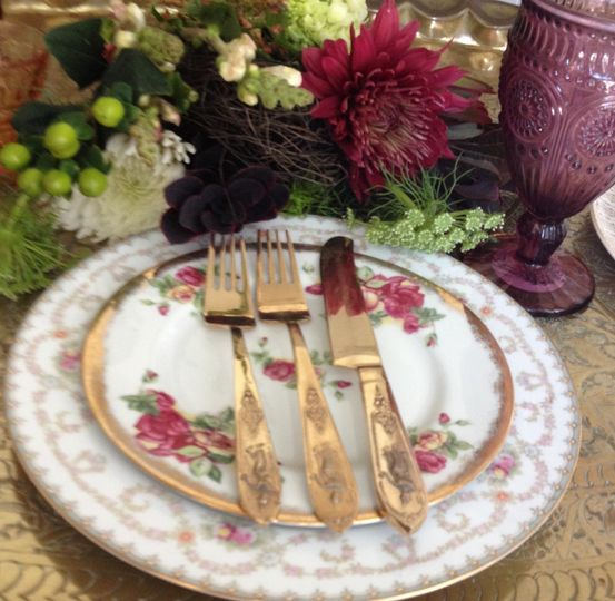Glam vintage mismatched rentals in collection with gold flatware