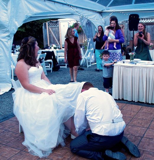 Groom taking off the bride's garter