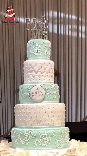 Five tier white and blue cake