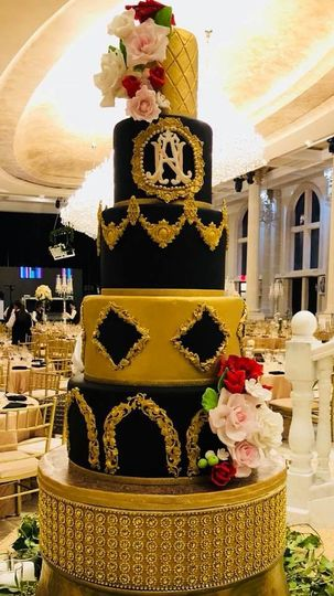 Five tier black and yellow cake