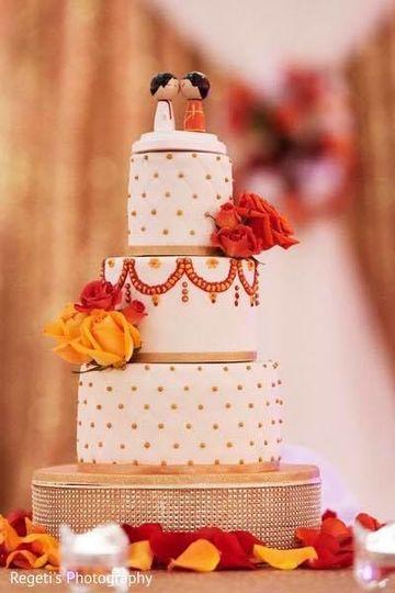 Three tier wedding cake with flowers