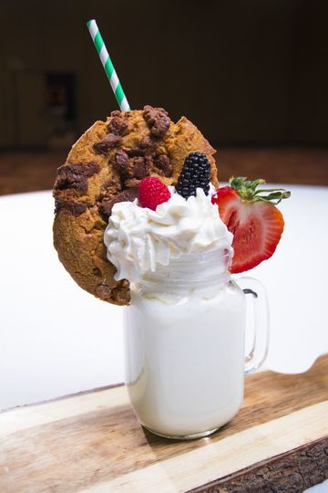 Vanilla freak shake with reese's cookie and fruit