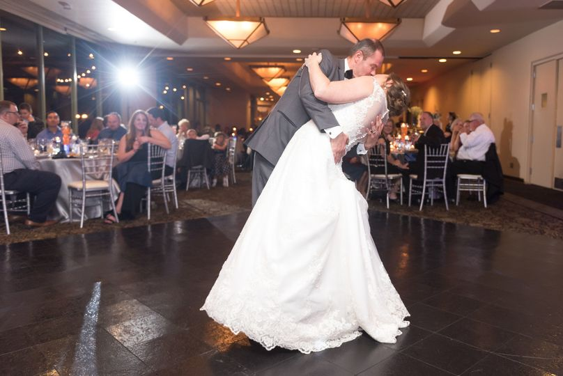 Newly weds share a kiss on the dance floor