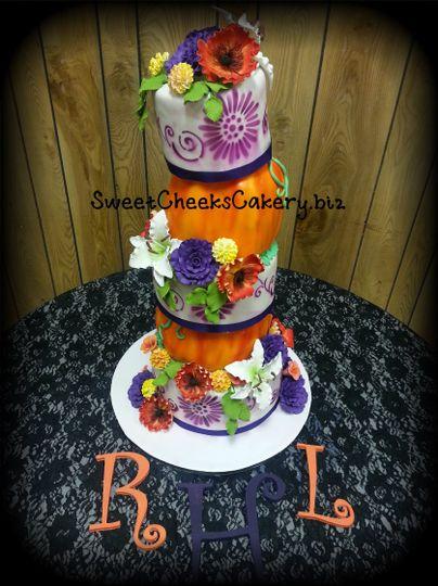 Hand sculpted pumpkins, air brushed patterns, hand made gumpaste flowers