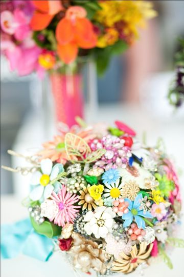 Family heirlooms and vintage pins add glamour and sentiment to this one-of-a-kind bridal bouquet --...