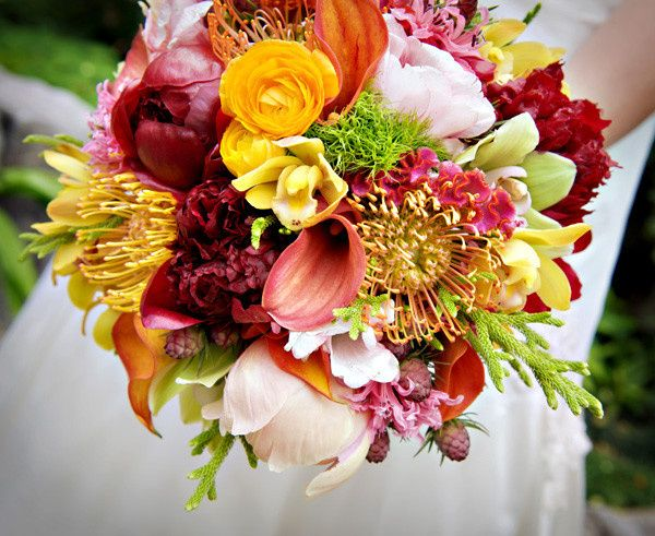 A textured arrangement with exotic, bright blooms.
