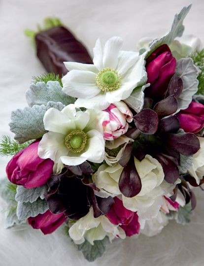 Winter-themed bouquet with white ranunculas, tulips, roses and lambs ear.