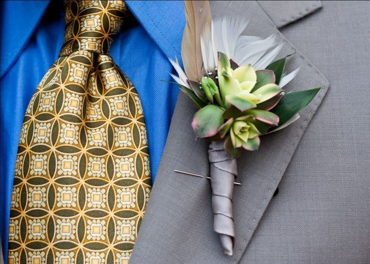 Succulent boutonniere with succulents and feather -- available any season.
