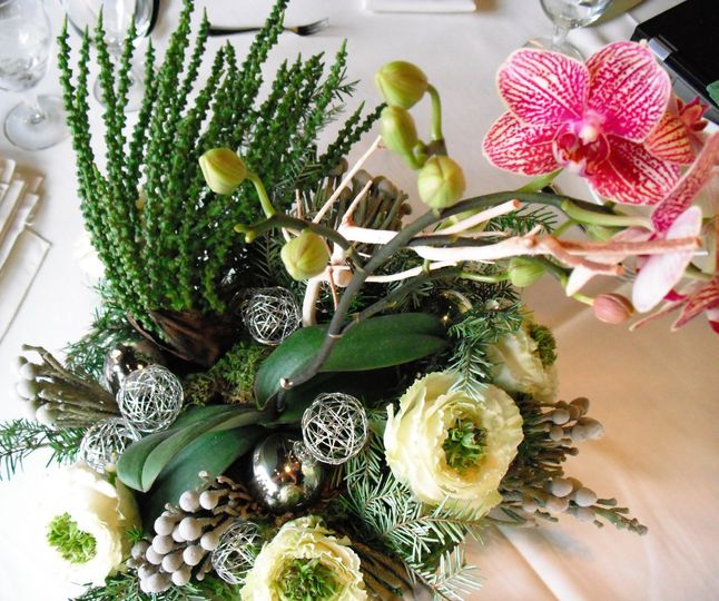 Live plants in this eye-catching centerpiece can be replanted at home or given to guests as...