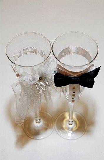 Bride and groom drink glasses