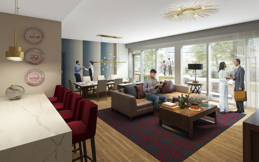 Hospitality suites available with outdoor patio overlooking views of Kyle Field