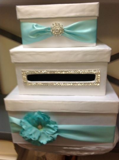 Boxes with teal ribbons