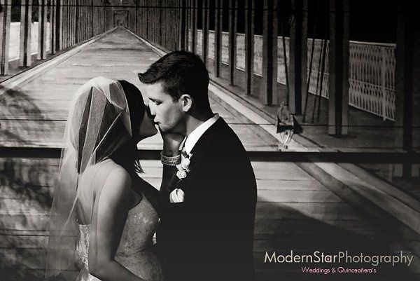 Bride and Groom Inside The Car Barn! Wedding photos here are beautiful!