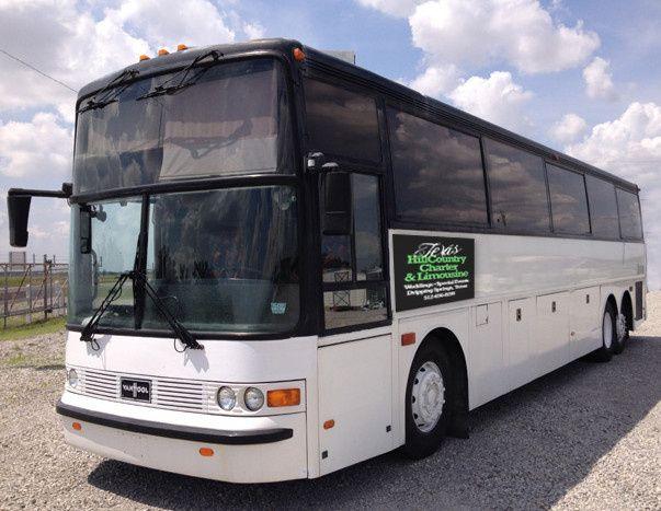 A 46 Passenger Van Hool Coach (5 hour minimum).