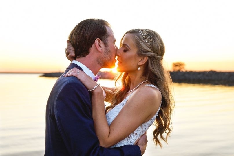 Couple kiss by the sunset