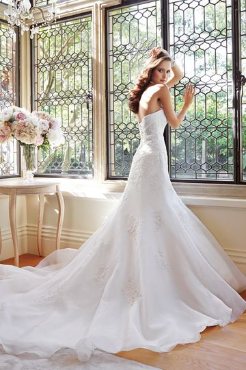 Y21449 - Marsha 2014 Collection – A slimming draped bodice accented with dainty lace appliqués...