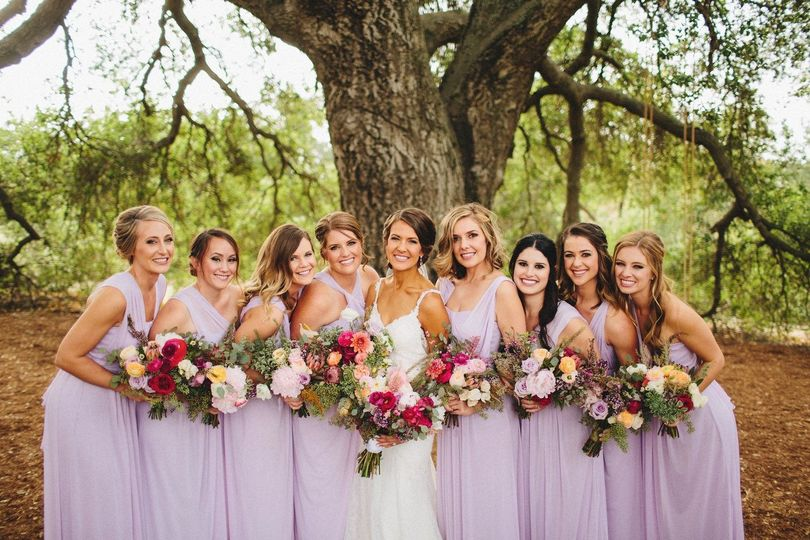 Bride and her bridesmaids in the woods