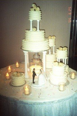 Vanilla scented candles set a romantic mood for this classic wedding cake! The white chocolate cream...