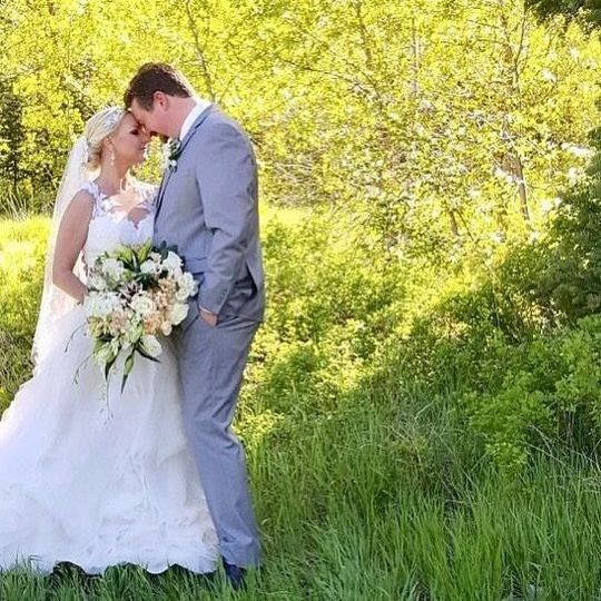 Newlyweds by the greenery