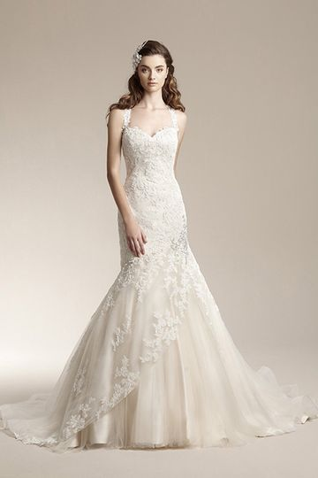 F151001	Romantic mermaid gown with tulle skirt and lace overlay. Dress features beaded accent at hip...