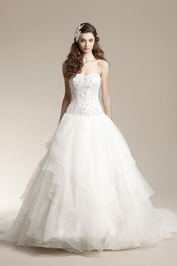 F151002	Romantic ball gown with sweetheart neckline and beaded and embroidered bodice. Skirt...