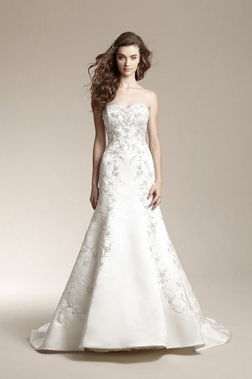 F151004	Classic mermaid gown with romantic beaded embroidery accents, sweetheart neckline, and satin...