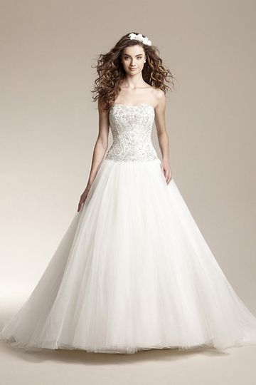 F151010Romantic ball gown with soft tulle skirt, semi-cathedral train, and beaded design on front...