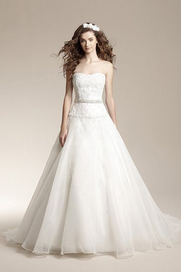 F151013Romantic ball gown with organza skirt, attached beaded waistband, and beaded accents on...