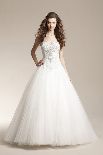 F151014Romantic ball gown with tulle skirt, Basque waistline, and beaded design on front and back...