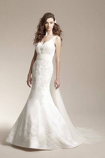 F151015Vintage inspired mermaid gown with beaded lace appliques. Dress features tulle waistband,...