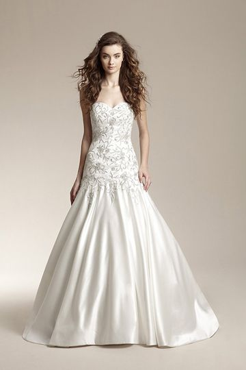 F151018A-line gown with fitted bodice and drop waist. Dress features sweetheart neckline and...