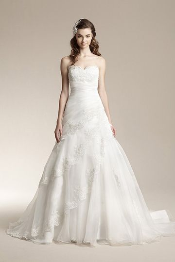 F151019Vintage inspired lace gown with gathered bodice and tiered organza skirt.