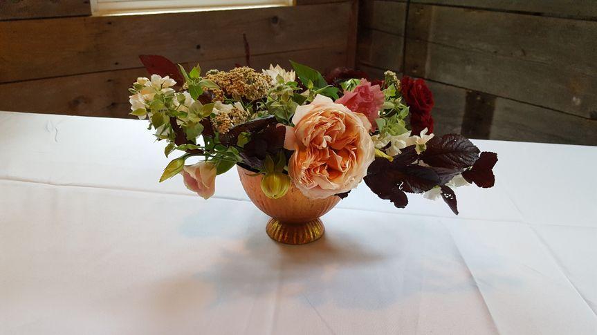 This darling centerpiece has Dahlias, Roses, and Wildflowers.