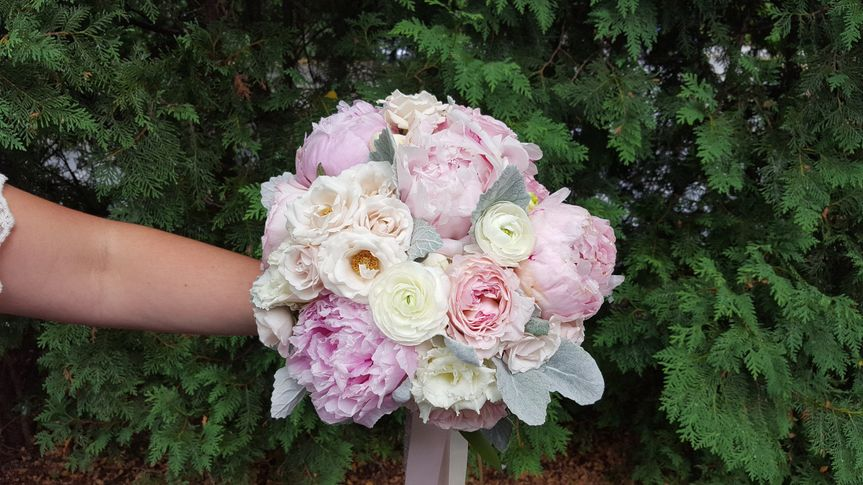 This romantic bouquet contains Garden Roses, Peonies, Roses, and Dusty Miller, great for a spring...